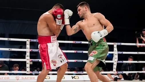 Украинский боксер Беринчик в зрелищном бою победил Симиона и защитил чемпионский титул